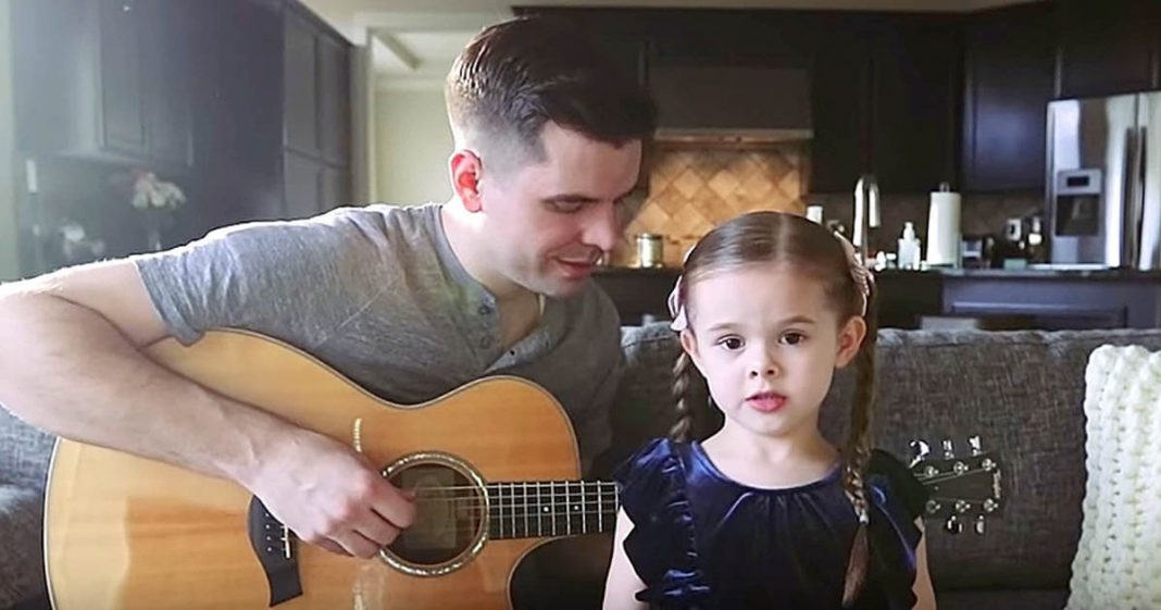The little girl announces her father that she will sing a song. The result melts everyone's hearts