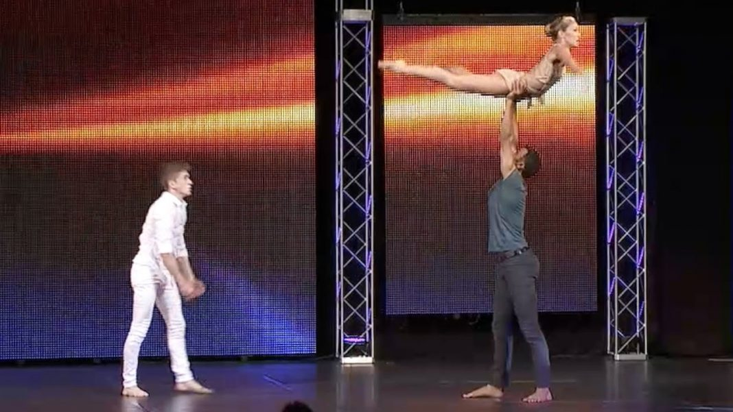 Two dancers step on the scene. When the third dancer joins them, the performance becomes breathtaking