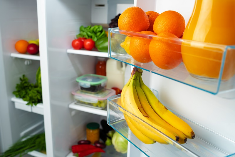 Why is it a good idea to keep oranges and bananas in the fridge?