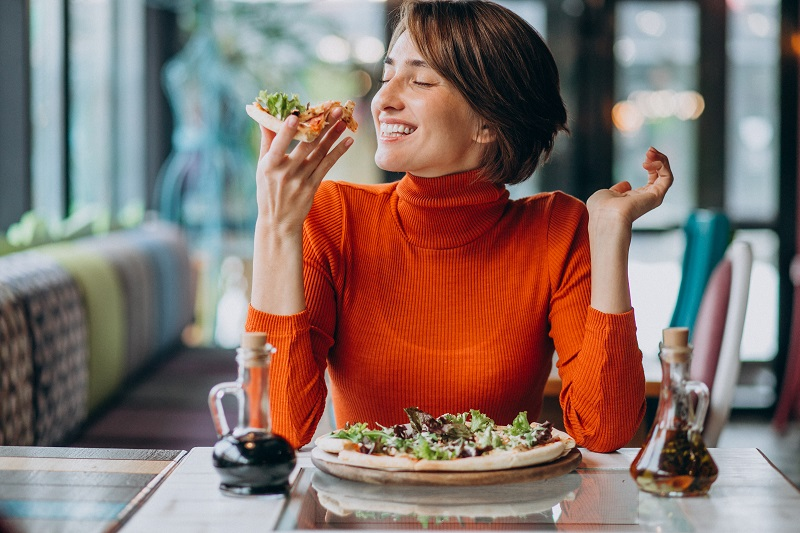 Why is it important to sit down while eating?